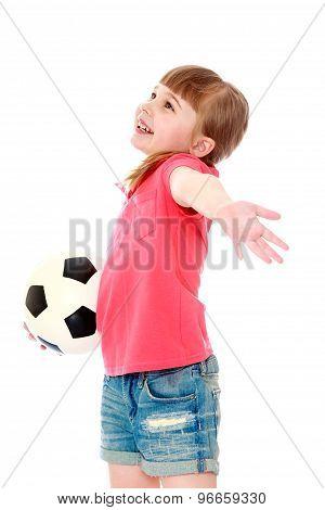 Little girl holding a soccer ball