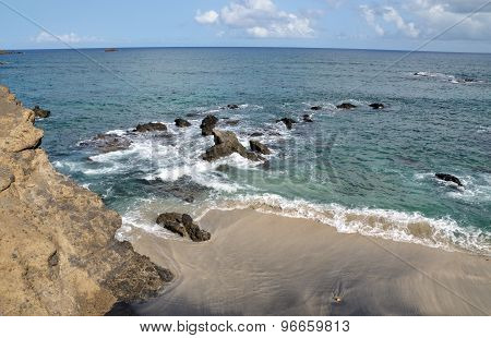 Cliff, Rocks Waves And Beach