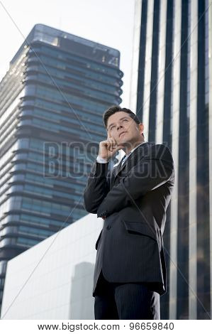 Corporate Portrait Attractive Businessman Outdoors Thoughtful In Business District