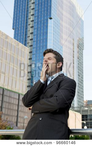 Exhausted Tired Businessman Yawning In Need Of Sleep After Long Hours Of Work