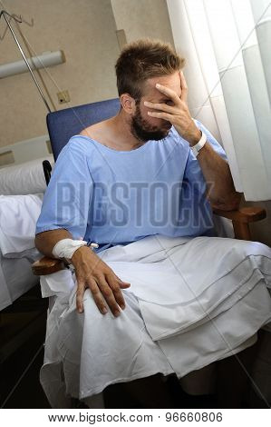 Young Injured Man Crying In Hospital Room Sitting Alone Crying In Pain Worried For His Health Condit