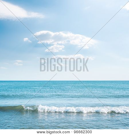 wave on sea and blue sky with clouds