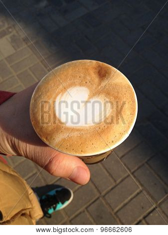 Cappuccino in the hands