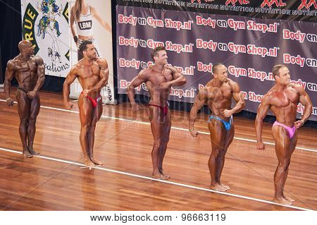 Male bodybuilders showing their best in a lineup comparison