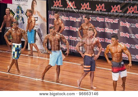 Male fitness contestants show their physique