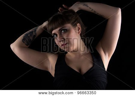 Photo of curvy woman with tattoo on hand