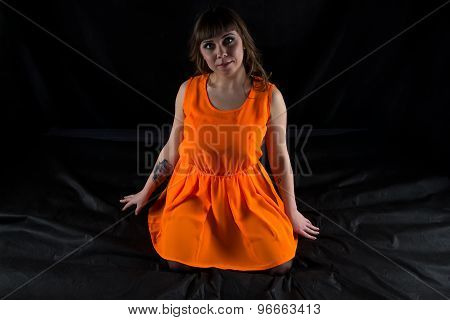 Photo of curvy woman in orange dress