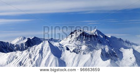 Panoramic View On Winter Mountains In Haze