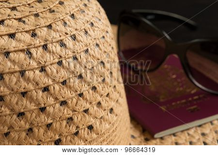 Sun hat and Passport on a black background