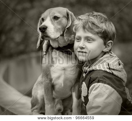 A portrait of boy and his beagle