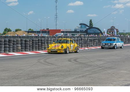 Bucharest, Romania - July 11, 2015: Old vintage retro cars parked near a speed circuit