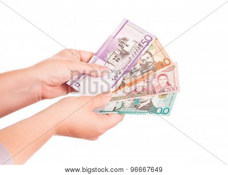Dominican Republic Money In Hands, Closeup Photo
