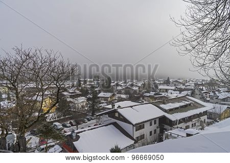 Small Town In The Alps, Covered With Low Clouds.