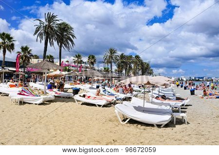 IBIZA, SPAIN - JUNE 16: Sunbathers in the popular Platja den Bossa beach on June 16, 2015, in Ibiza Town, Spain. Ibiza is a well-known summer tourist destination in Europe