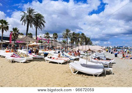 IBIZA, SPAIN - JUNE 16: Sunbathers in the popular Platja den Bossa beach on June 16, 2015, in Ibiza Town, Spain. Ibiza is a well-known summer tourist destination in Europe