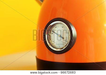 teapot chrome thermometer on yellow background