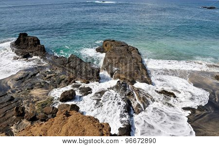 Waves Washes Over Rocks