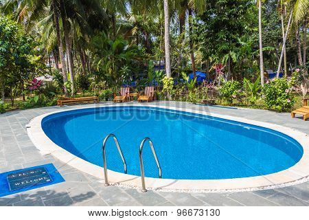 Swimming Pool In Tropical Resort With Garden
