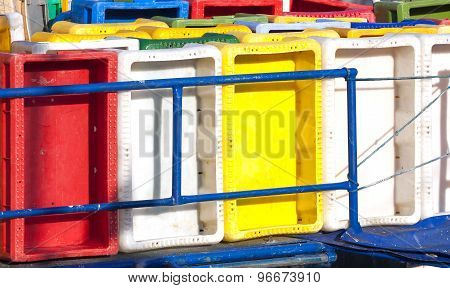 Colorful Plastic Fish Containers In A Port.
