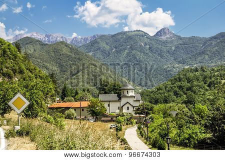 Monastery On The River Moraca Amid Mountains In The Background. Montenegro