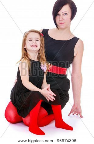 Fashionably dressed mother and daughter