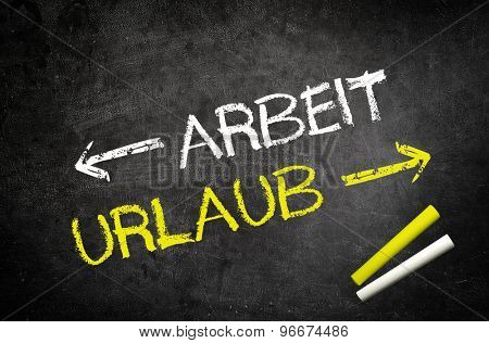 Conceptual Work and Vacation Texts in German Language with Arrows Written on Black Chalkboard with White and Yellow Chalks in the Corner