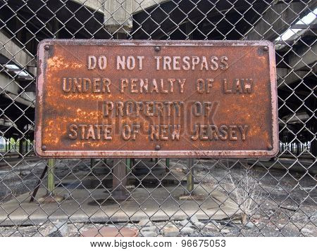 Rusted Trespassing Sign