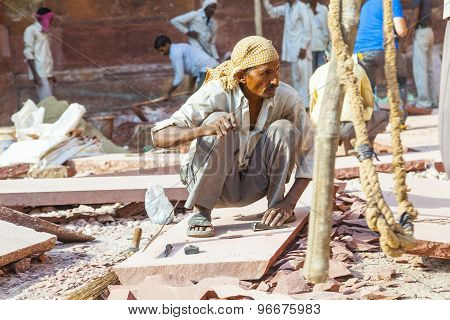 Worker Prepares Sandstones For Renovation Of The Red Fort