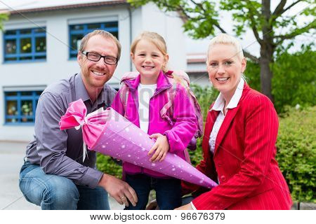 Family bringing daughter to first day at school