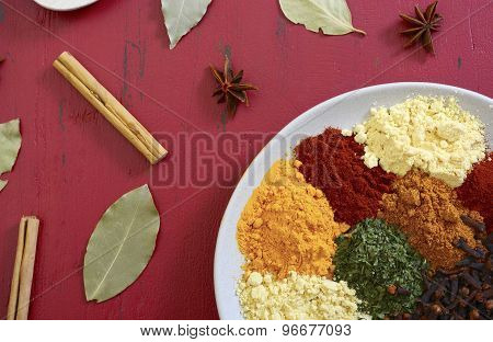 Colorful Cooking Spices On Wooden Table
