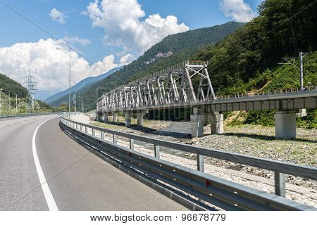 highway and railway bridge over Mzymta River in the mountains