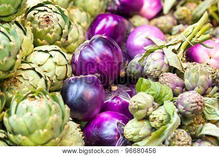 Fresh Artichokes And Eggplants At A Farmers Market, London