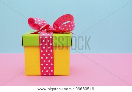 Bright Color Gift Box On Pink And Blue Background.