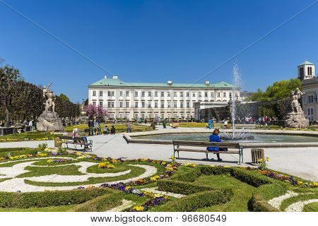 People On A Bench Relax In The Mirabell Gardens