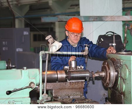 Druzhkovka, Ukraine - December 25, 2012: Turner In The Workplace. Druzhkovka Heavy Engineering Plant