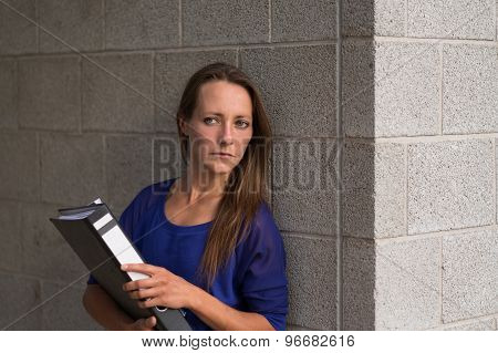 Businesswoman Clutching An Office Binder