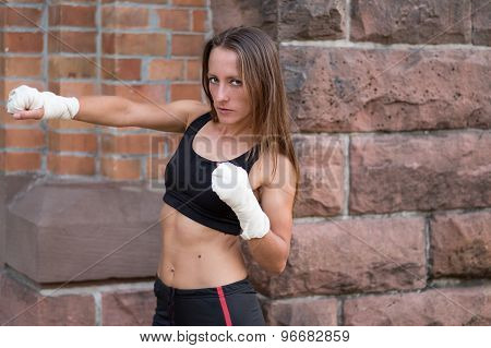 Young Female Boxer Working Out
