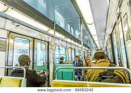 Tourists And Locals On A Subway Train In Paris