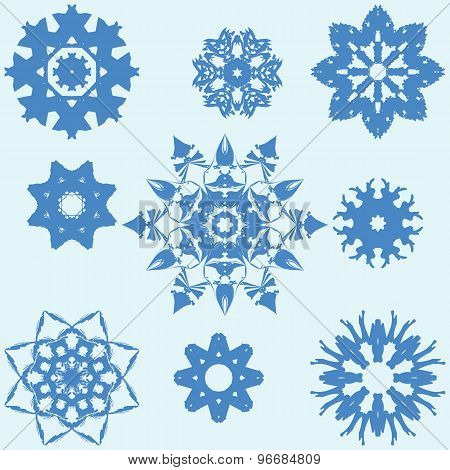 Vector glossy blue snowflakes with blue color.