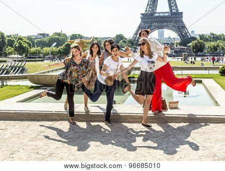 Tourists Pose In Front Of Eiffel Tower In Paris, France