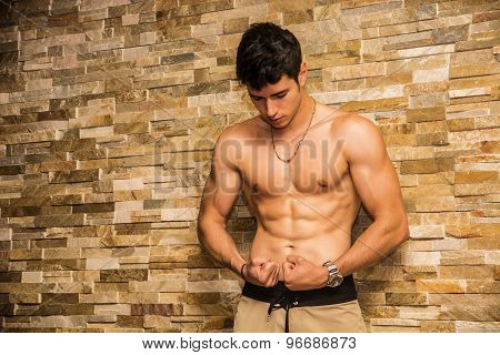 Attractive and muscular shirtless young man