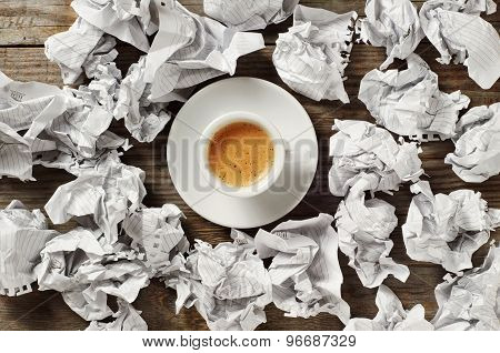 Cup Of Black Coffee And Crumpled Paper