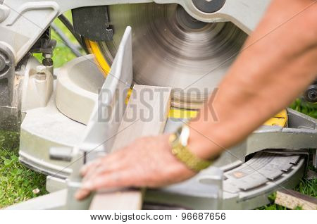 man working with an electrical sander