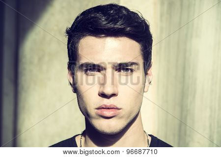 Handsome young man's headshot, indoor, lit by sunlight