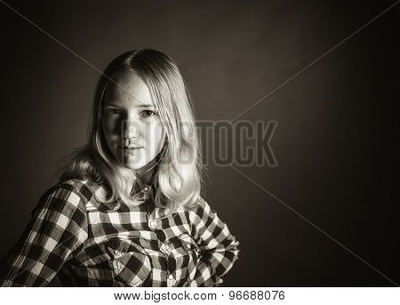 High contrast black and white portrait of a teen girl