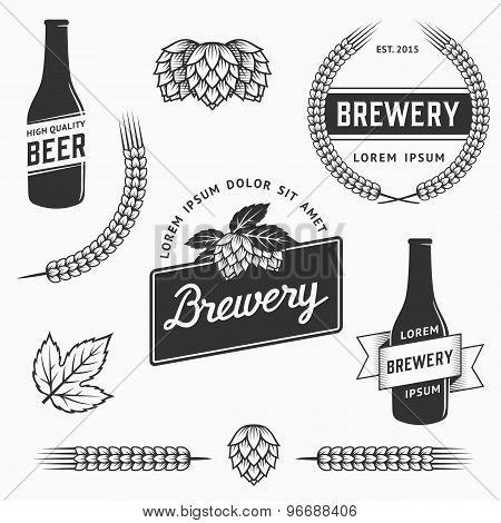 Vintage set of brewery logos, labels and design element. Stock vector.