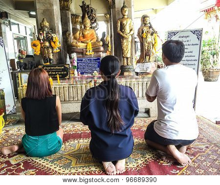 Family praying in a buddhistAsia family praying in a buddhist