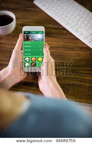 Woman using smartphone against gambling app screen
