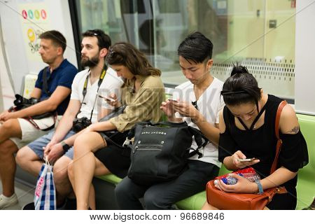 SINGAPORE - CIRCA FEBRUARY, 2015: Passengers traveling on the subway in Singapore. The MRT network encompasses 152.9 kilometres of route, with 113 stations in operation.