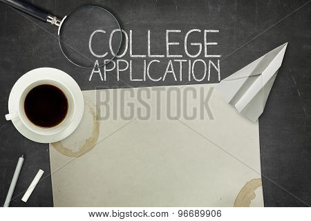College application concept on black blackboard with empty paper sheet